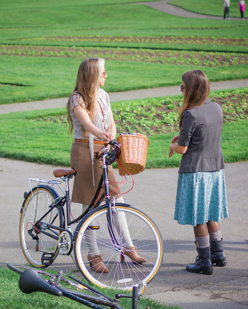 Great style and good genes. This mother-daughter pair came all the way from Sacramento to attend the Tweed Ride! And check out that cute penny-farthing print on her blue skirt. You can find more   bike print dresses here.