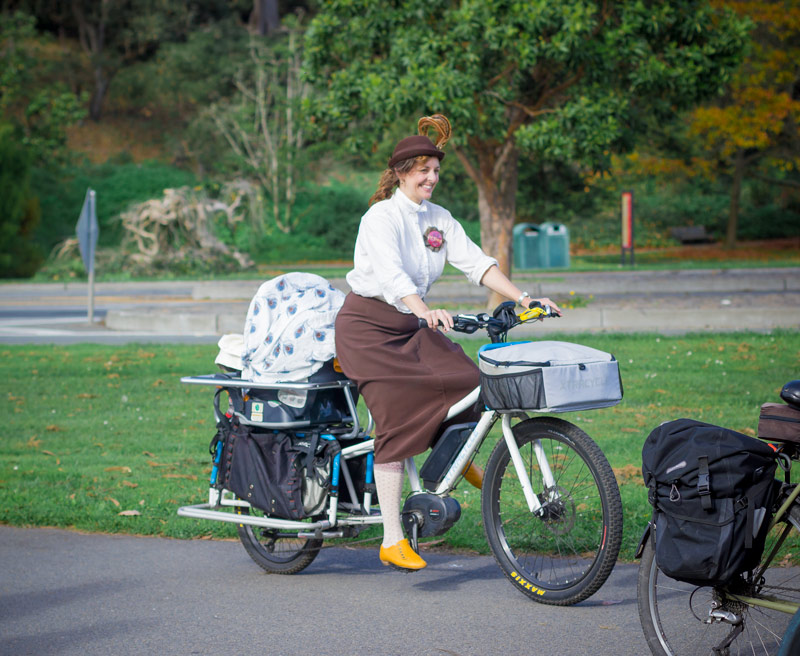 Magnificent Mother-of-Twins Charlie Flaherty and her miraculous (borrowed) baby-toting bike.  Not shown: the other baby who happened to be riding with his dad.
