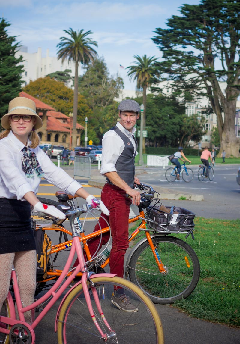 Mark Stockmann Sullivan is modeling the stuffing out of his wool and corduroy ensemble. And I am struck by how delightfully incongruous our California palm trees and Mission style architecture look as a backdrop for an anglophilic bike ride.