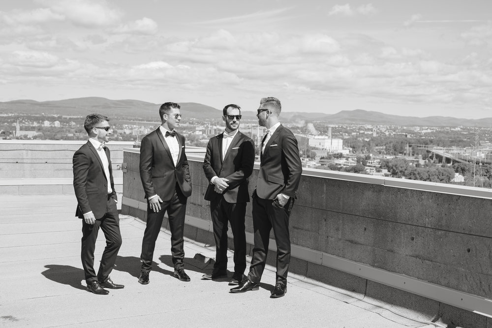 Groomsman and the view on magnificent Quebec City