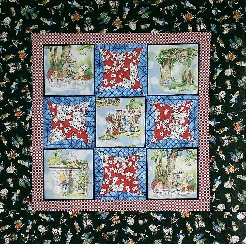 The panels used in this quilt are reproductions of the original art work used in the first edition of Through the Looking Glass.