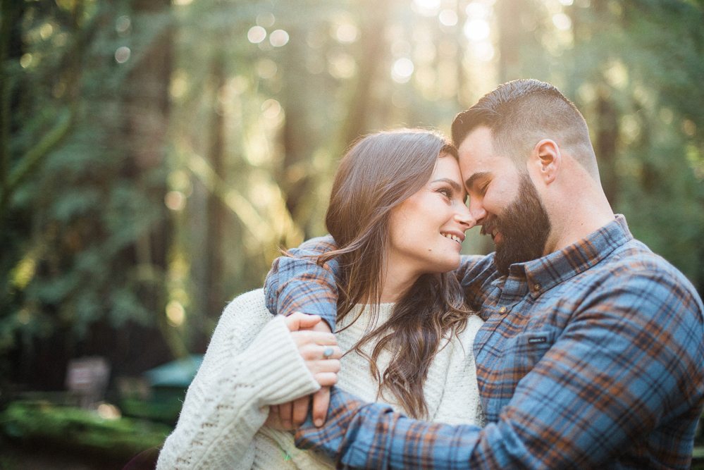 Couple in forest with foreheads together