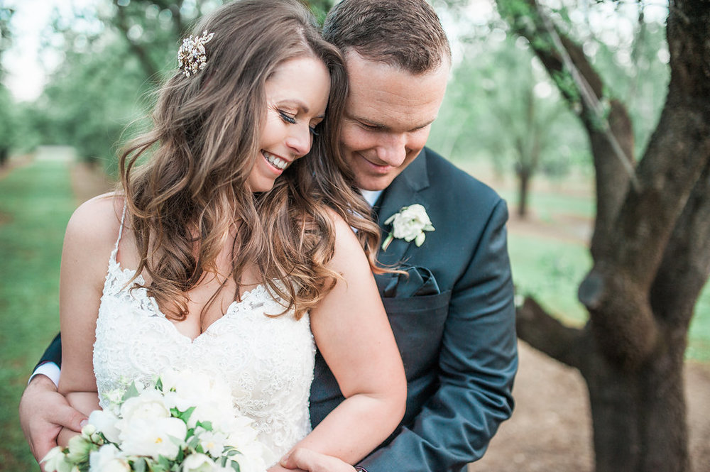 bride & groom smiling - Heather Selzer