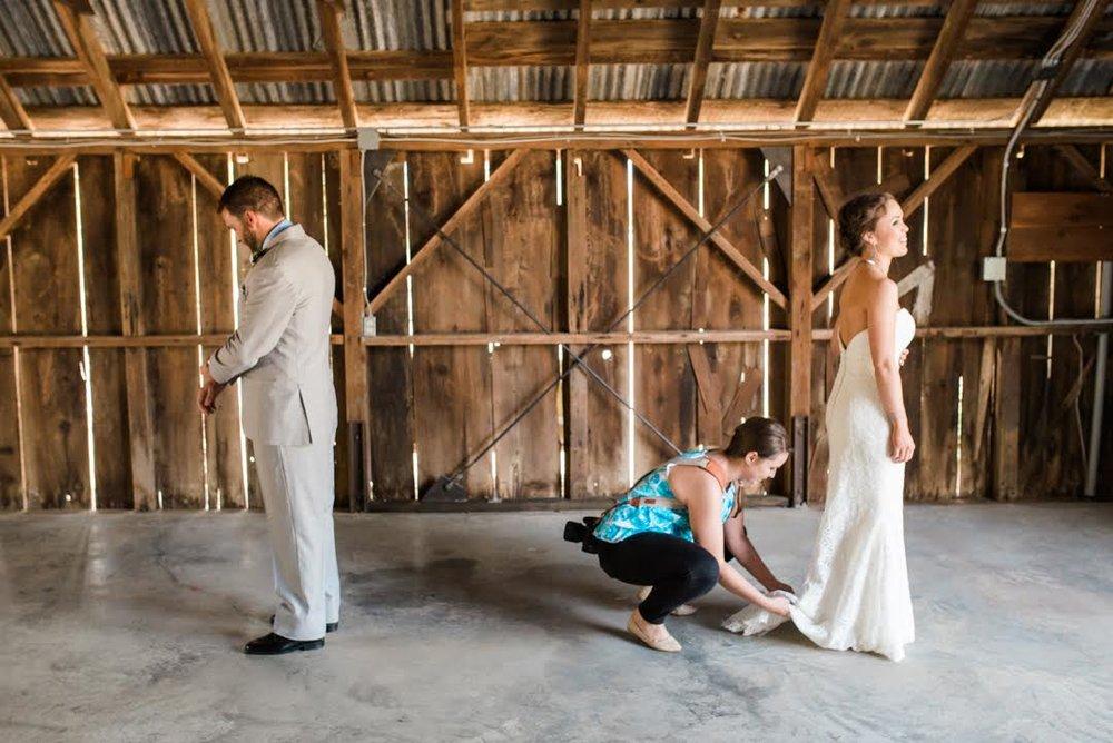 heather selzer helping bride adjust dress photo by shannon rosan