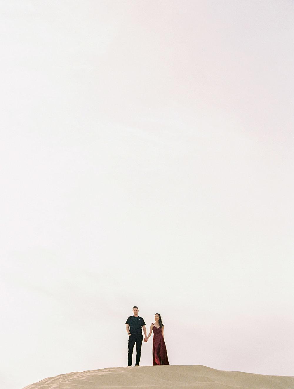46CHRISTINEANDJOSH_SANDDUNES_ENGAGEMENT_SALLYPINERAPHOTOGRAPHY_-131.jpg
