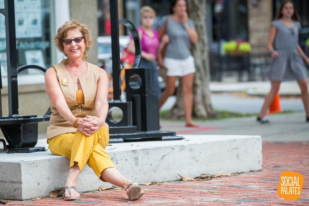 Deborah sits at the foot of one of the Austin Collins public art installation