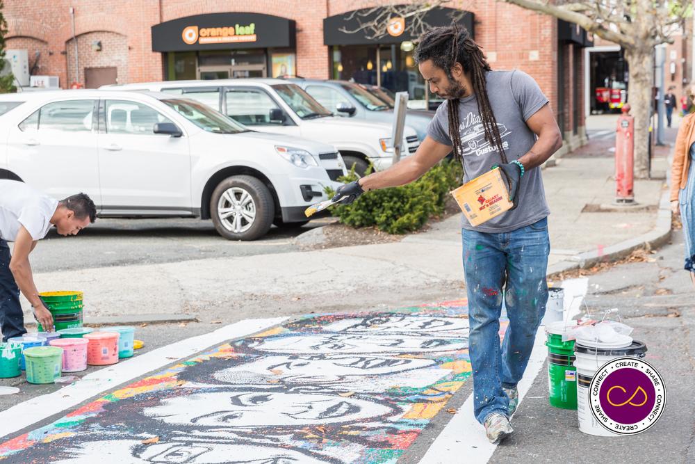 Ruben Ubiera paints a crosswalk in the LOLA Point Area of Salem MA