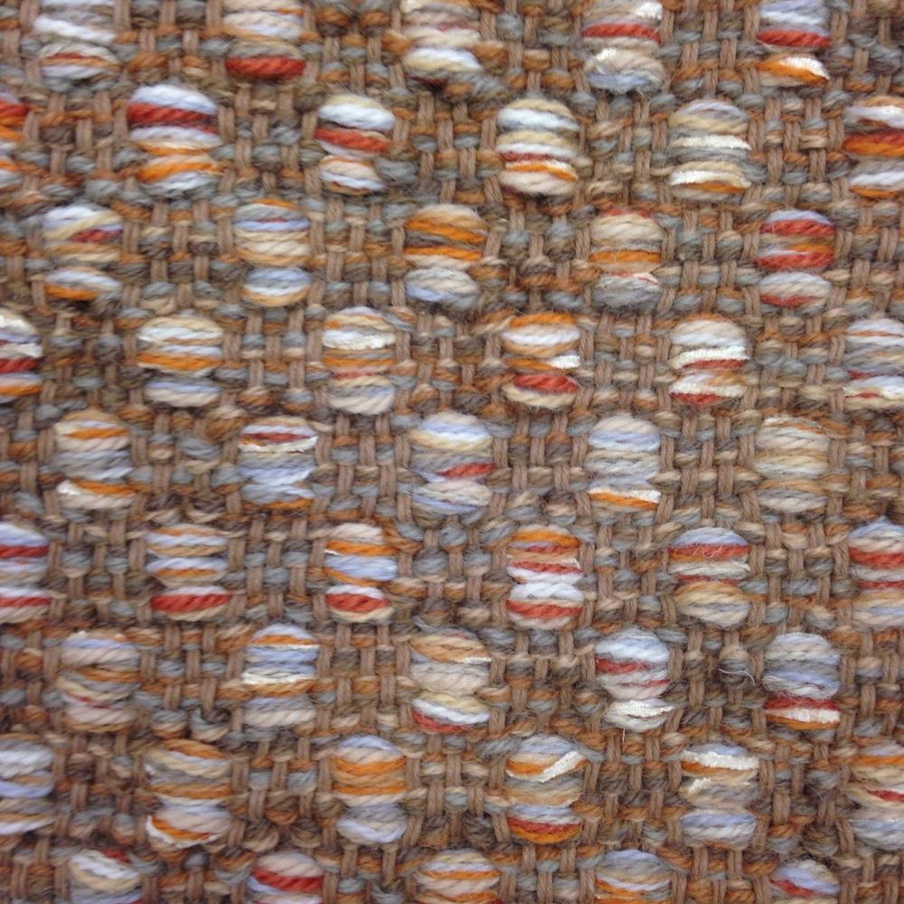 Mosaic hand woven rug.