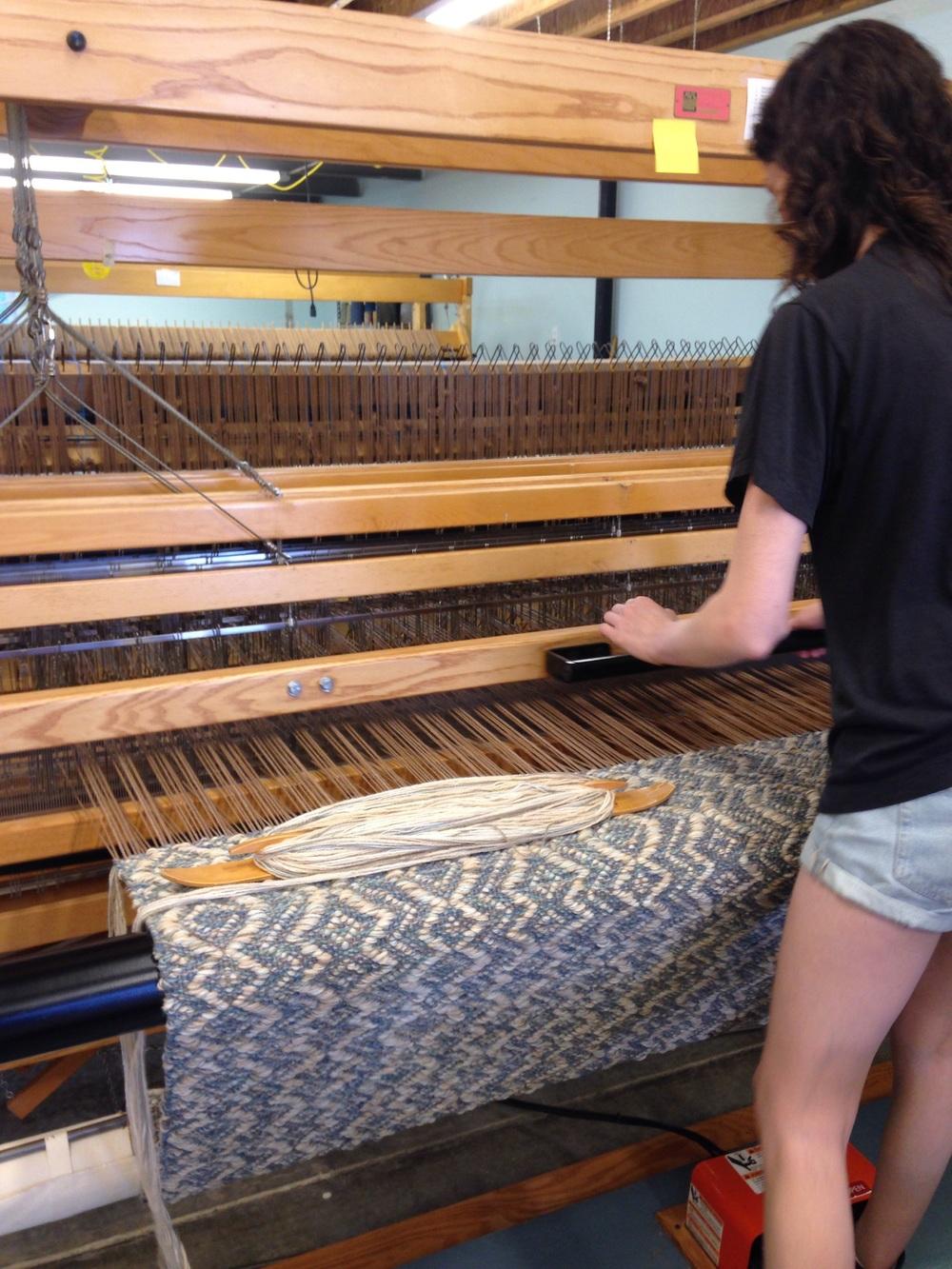 Meg weaving a handwoven rug.