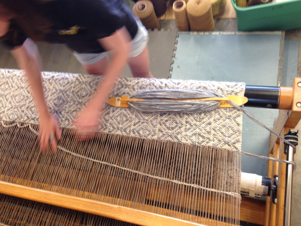 Meg weaving Marcus B Cloud handwoven rug.