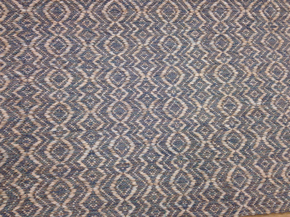 Amphora Wedgewood flat weave rug.