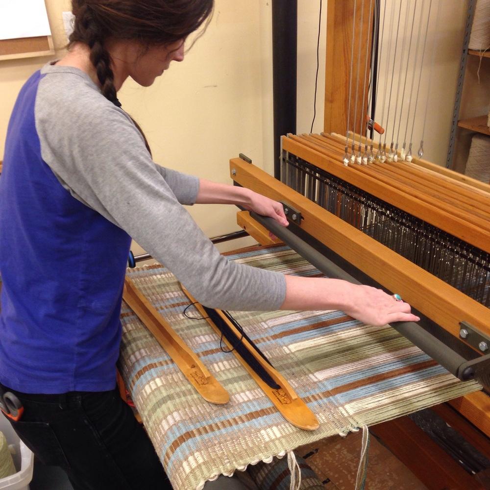 Meg weaving a Rep weave handwoven rug.
