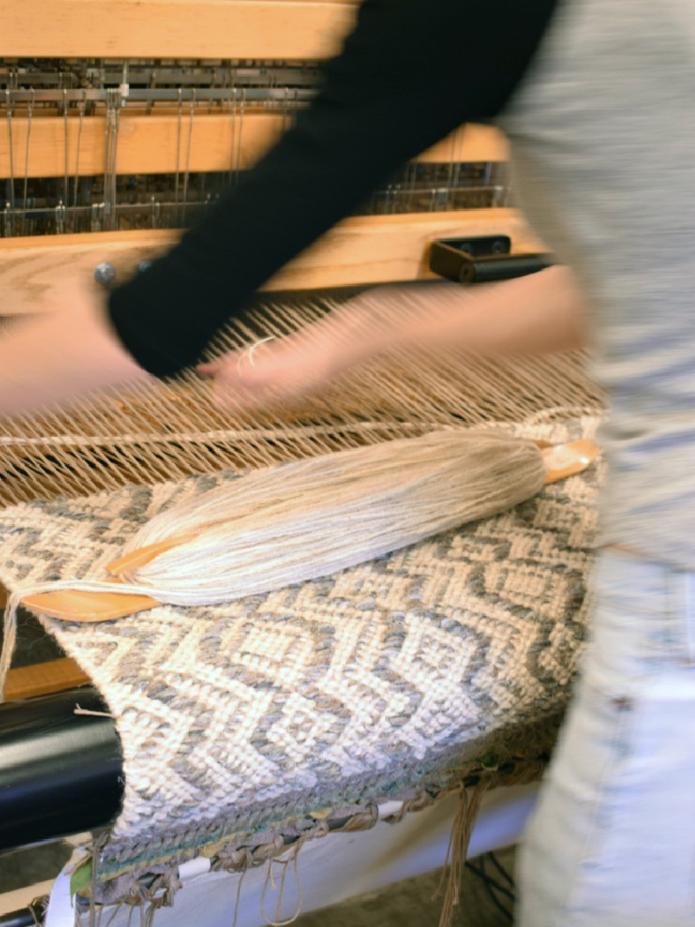 Meg weaving at True North Textiles.
