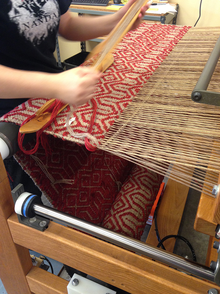 Kate weaving at True North Textiles.