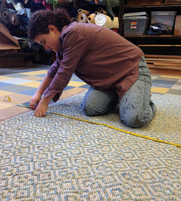 Kate measuring shadow Weave Aqua handwoven rug.
