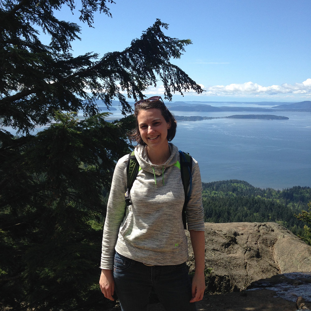 Amy Tyson with view from Oyster Dome, WA.