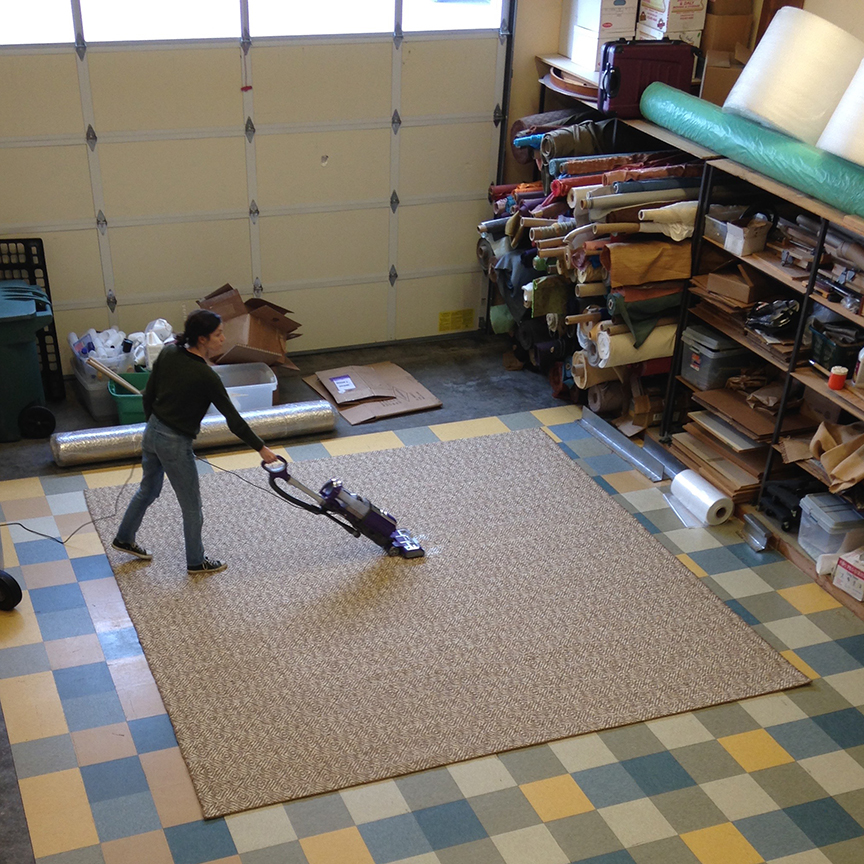 Meg vacuuming finished rug.