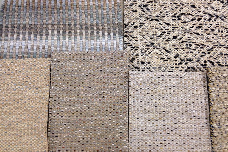 Samples of Handwoven rugs. Columns Fog, Marcus R Black & White and 3 colors of the Blink pattern.