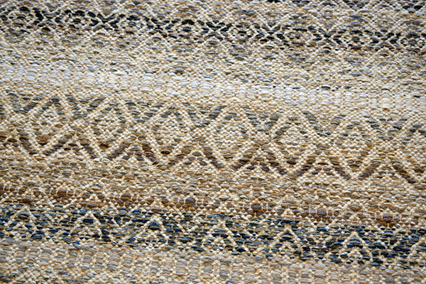 Closeup of Multi weave rug.