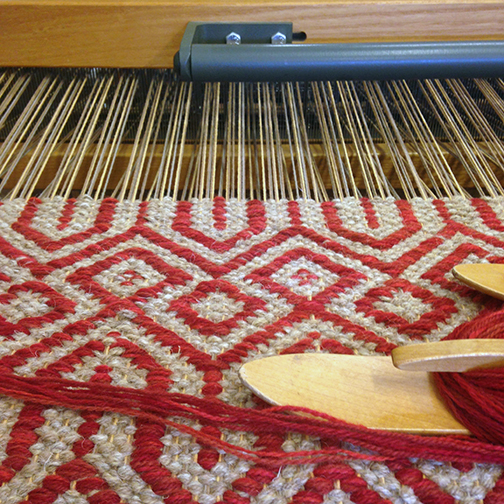 Steeple 2 Red on the loom at True North Textiles