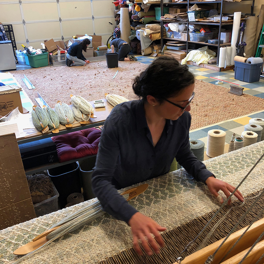 Michelle weaving at True North Textiles.