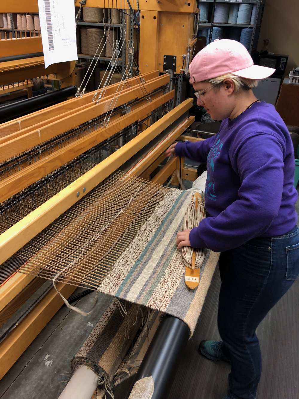 Sarah weaving one of the striped runners