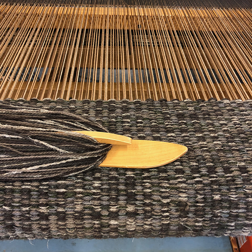 Custom charcoal Columns rug on the loom.