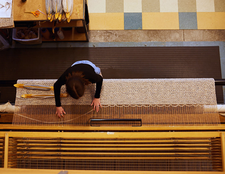 Meg weaving on our largest loom, Thor.