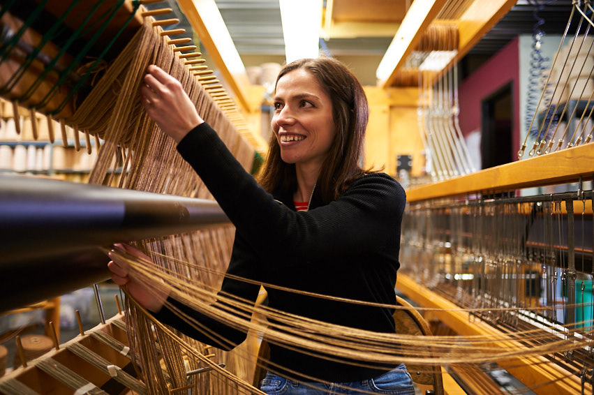 Meg threading our 10' loom, Gladys.