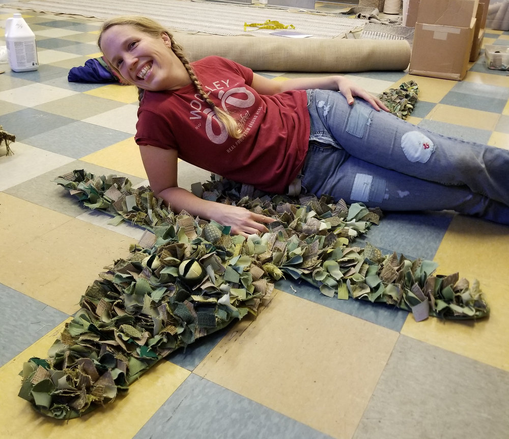 Aurora with her completed alligator rug