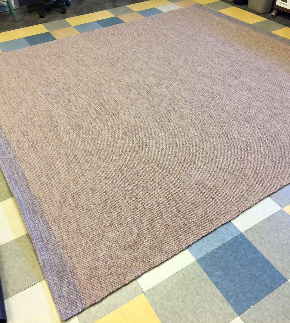 The completed lavender dining room rug is nearly 10x10 feet.