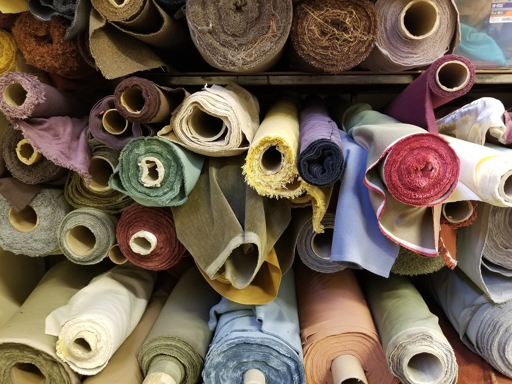 Fabric rolls in the True North Textiles shop.