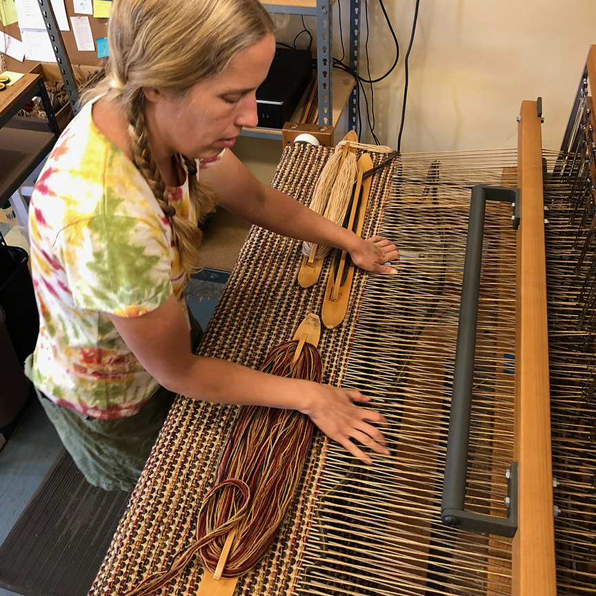 Aurora weaving a plain weave runner.