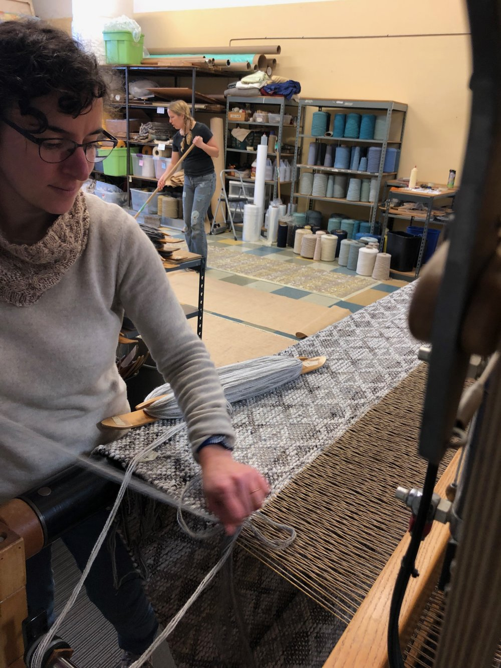 Michelle weaving Bases and Aurora backing.