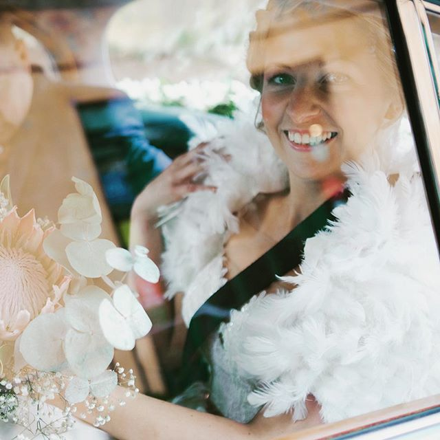 Gorgeous Faye arriving in style...love her feather cape ❤️❤️ #weddingcape #feathercape