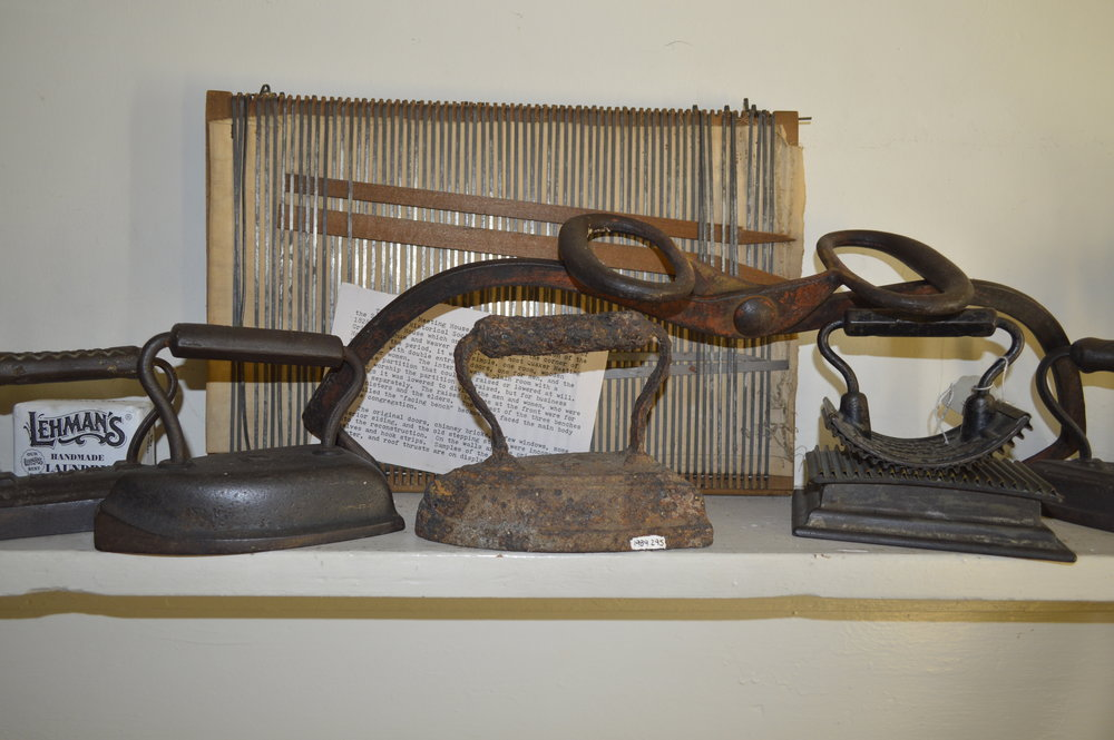 These heavy irons needed to be heated on a stove before they could be used.