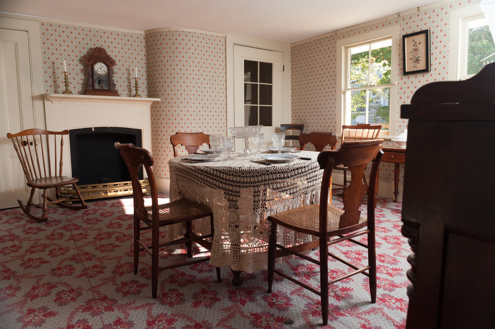 The wallpaper, paint colors, and carpets throughout the house were authentic reproductions of popular designs in the 19th century. The dining room carpet design is named Ballstone.