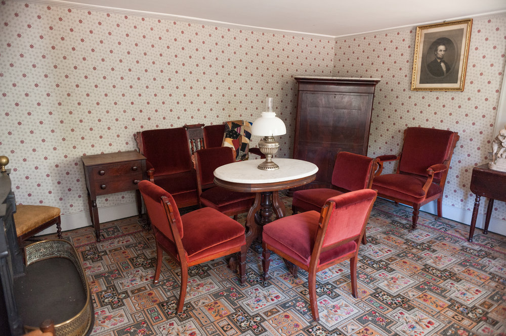 The parlor room was designed with East Lake furniture popular during the Victorian era.