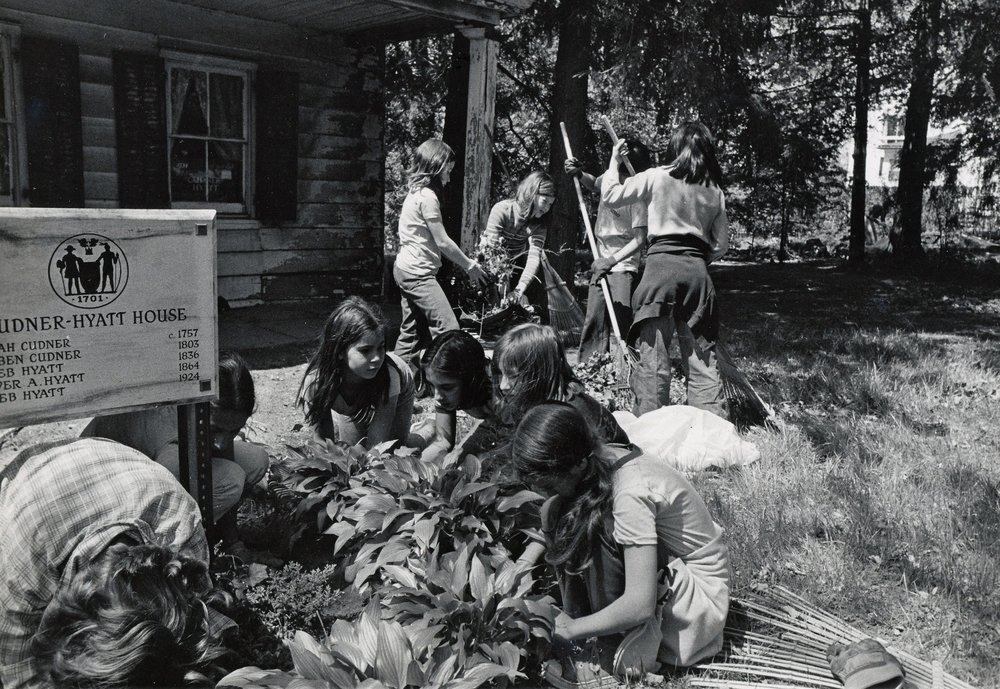 School children and volunteers helped clear the debris in the garden, 1975.