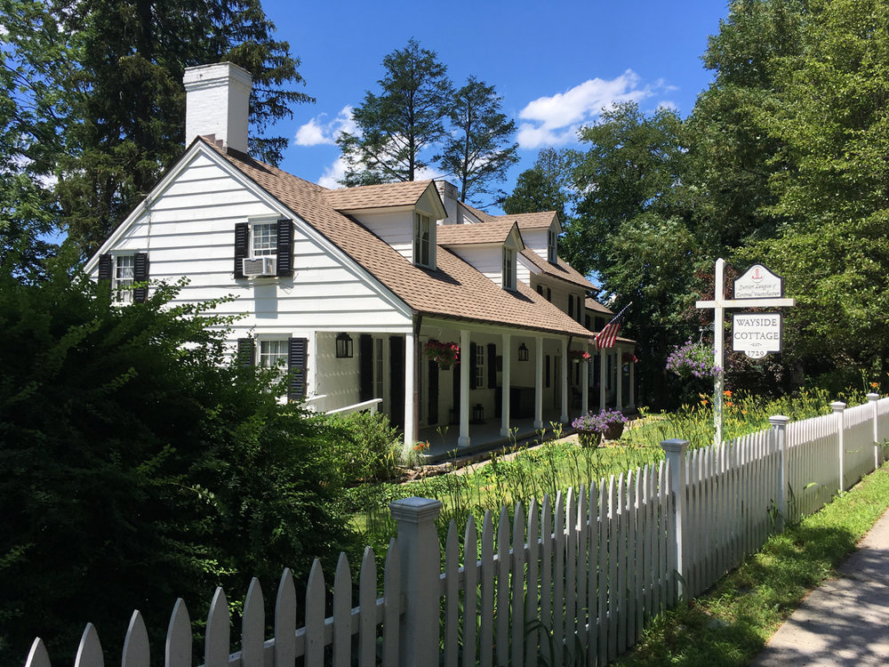 The Wayside Cottage is one of Scarsdale's oldest  houses. The date the cottage was built is unknown, but Caleb Heathcote, the founder of the Manor of Scarsdale, conveyed the land to Edmund Tompkins in 1717.