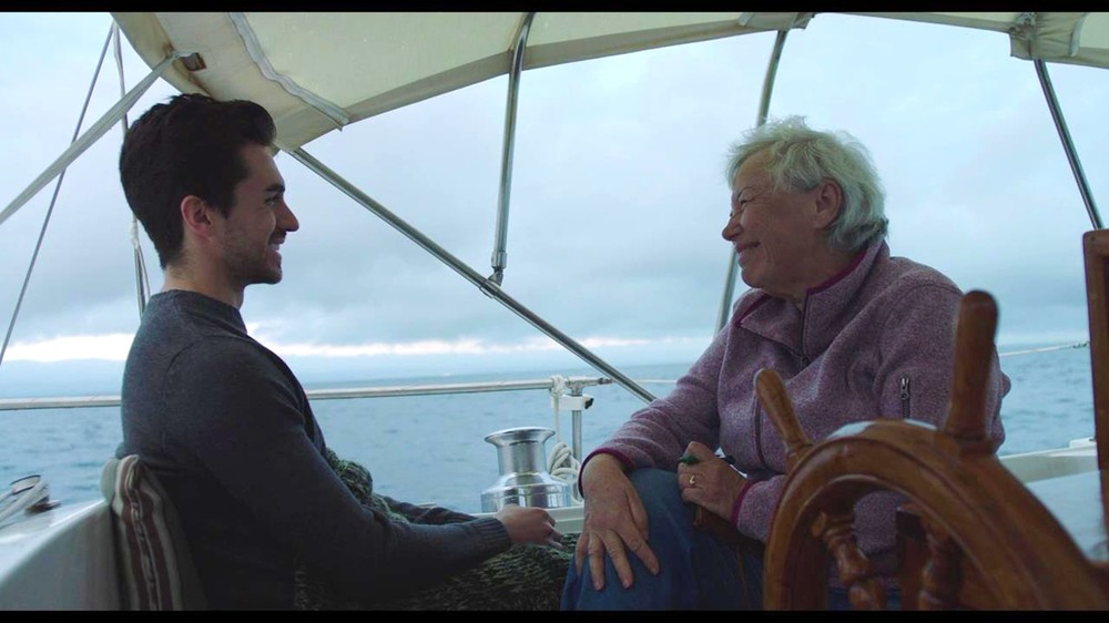 Both smiling at helm.jpg