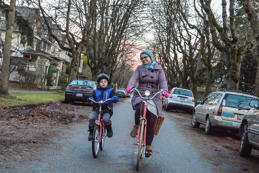 Melissa and Etienne pedalling side-by-side on the 10th Avenue Bikeway.