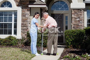 stock-photo-19636931-nurse-helping-senior-man-with-walker-in-front-of-house.jpg