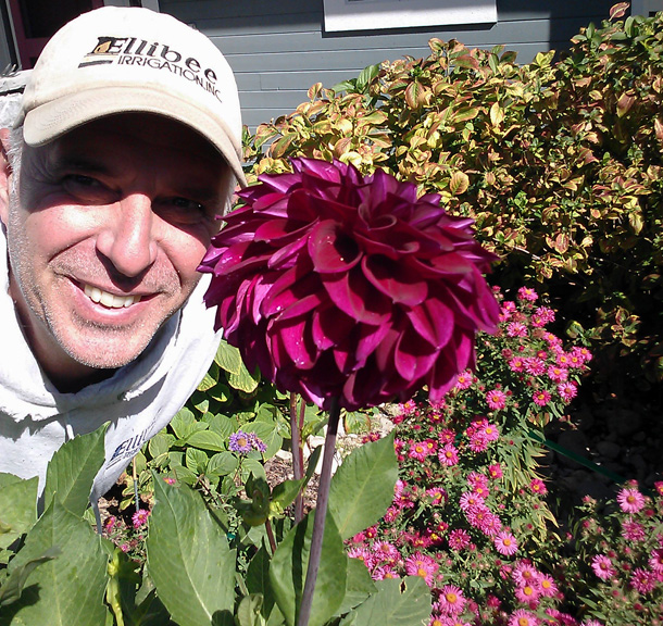Chuck Ellibee poses with a lovely flower.