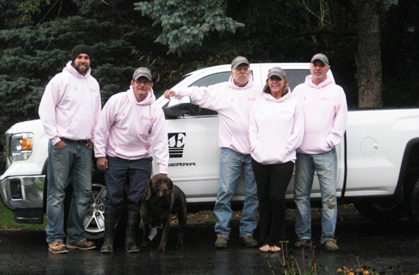 The Ellibee Irrigation crew (and Bentley) sporting their Breast Cancer Awareness Month garb.