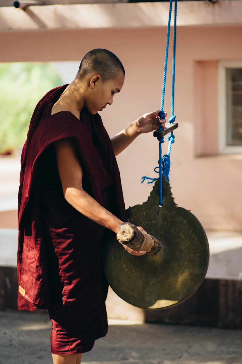 Monk ringing bell
