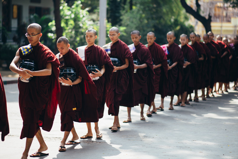 Monks on their way to eat lunch.