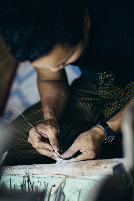Burmese man sculpting