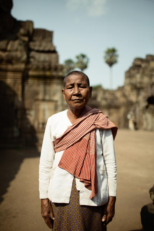 Cambodian woman standing in front of the Vat Nokor