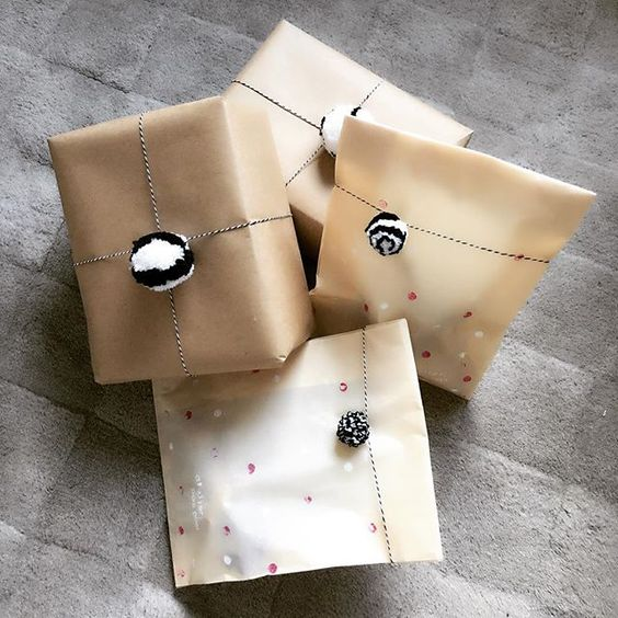 Monochrome - I love the look of these packages with black & white pom-poms. These are a cinch to make with a Loome tool and some stripey baker's twine. (Image from @ateliepompom)